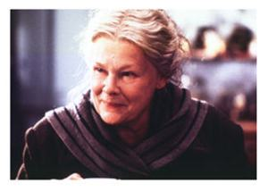 Dame Judi Dench in Chocolat Long hair shows femininity and vulnerability
