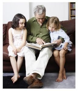 kids reading with grandparent