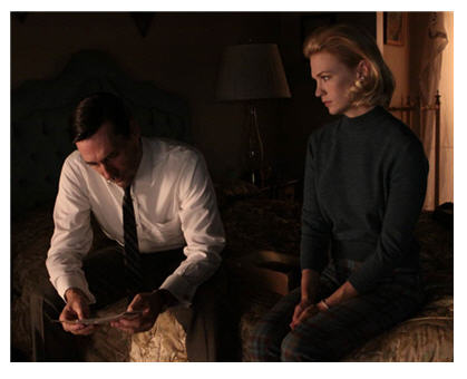 Brilliant lighting enhances the power of this scene of disclosure: Don in white and his face half lit; Betty, backlit.